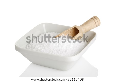 bowl of sea salt with wooden shovel isolated on white