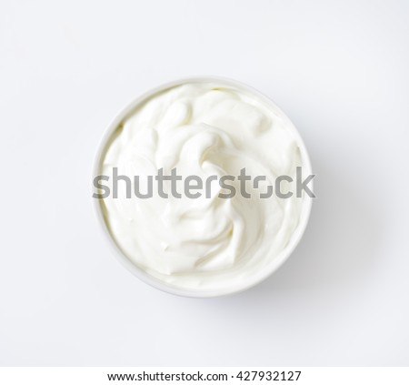 bowl of white yogurt on white background