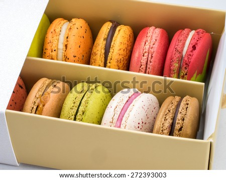 Box of colorful macaroons, just open to see inside