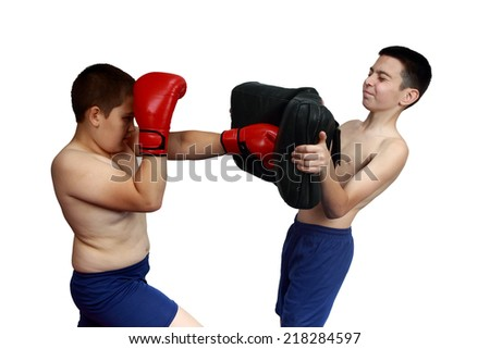 Boxer in red gloves protects from being hit and punch the the exercise machine for working off of blows