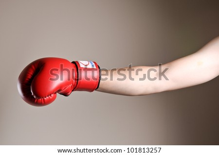Boxer punching in studio