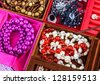Boxes of different colors with lots of  jewelry - stock photo