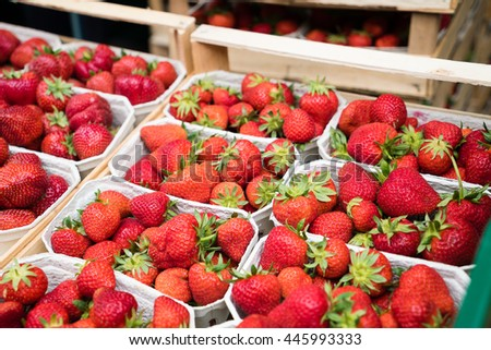 Boxes of strawberries in farmer market
