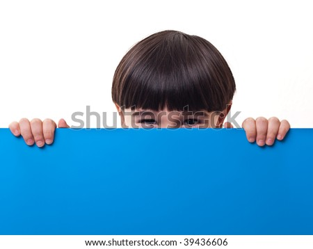 Boy and blue board with copyspace