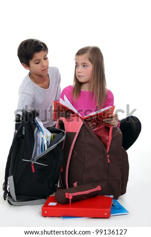boy and girl doing their homework after school