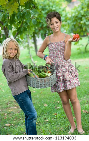 Boy and Girl Holding Basket of Vegetables,Italy