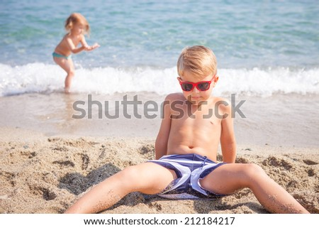 boy and girl playing on the sea coast