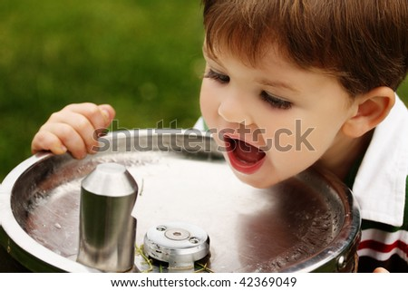 Boy at Water Fountain