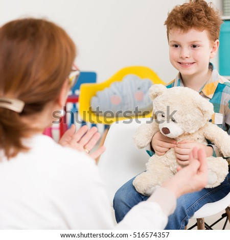Boy during therapy session with child psychologist