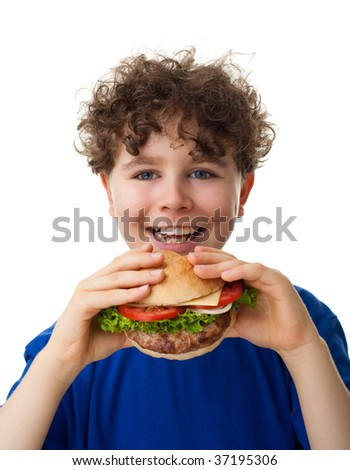 Boy eating sandwich isolated on white background