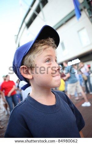 Boy going to a baseball game