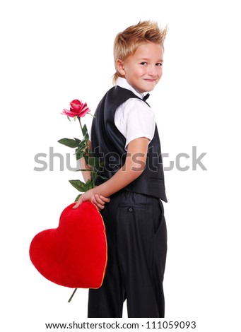 Boy hiding heart pillow and rose behind his back