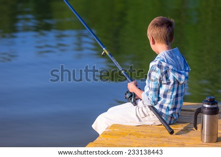 Boy girl fishing rods fishing together stock photo for Girl fishing pole