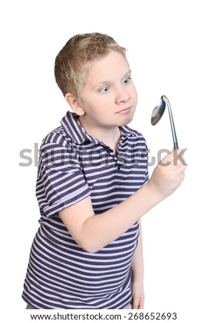 Boy is  bending spoon by concentration of mind force
