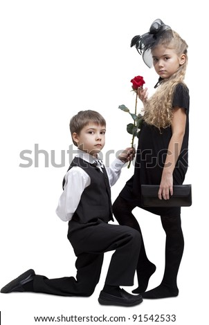 Boy is giving a rose to little girl, isolated on a white background.