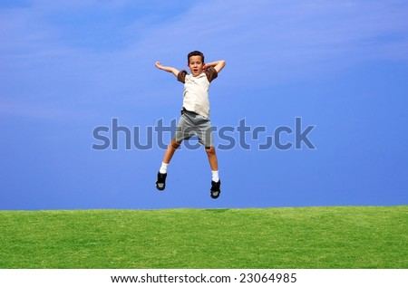 Boy jumping for joy on a clear day