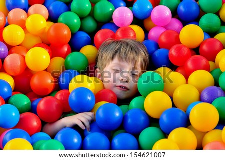 Boy playing in ball pool.
