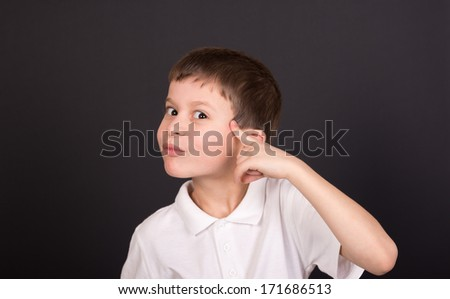 boy portrait in white shirt on black