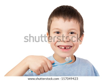 Boy portrait with lost tooth on toothbrush