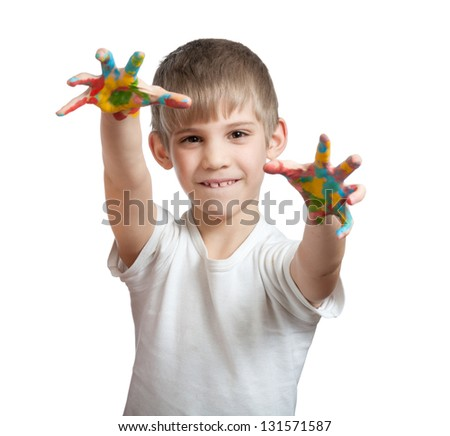 boy shows his hand smeared in paint, isolated on white