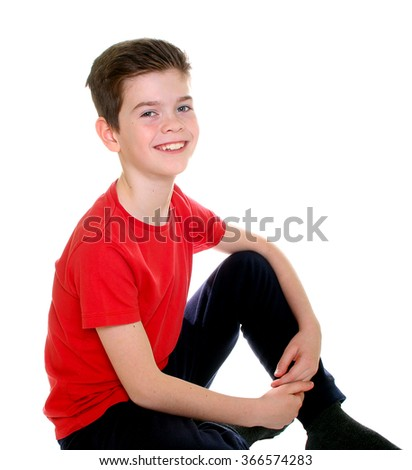 Boy sitting in casual clothes over white background
