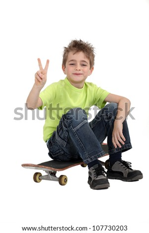 Boy sitting on skateboard