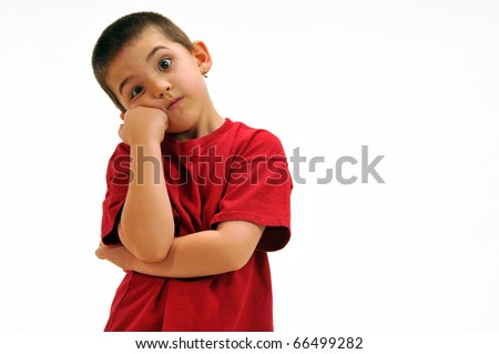 Boy with arm crossed and leaning his cheek on his fist feeling a little impatient and frustrated.
