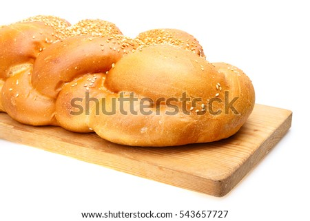 Braided shabbat challah on wooden desk isolated on white background