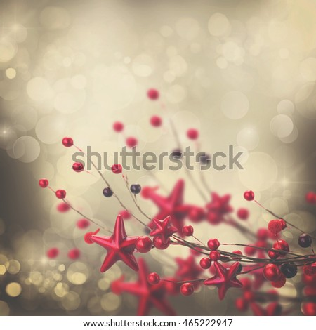 branch of christmas stars and berries on silver bokeh background, retro toned