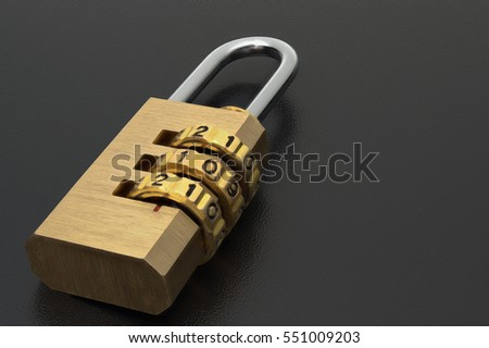 Brass lock with the code set on the dark surface.