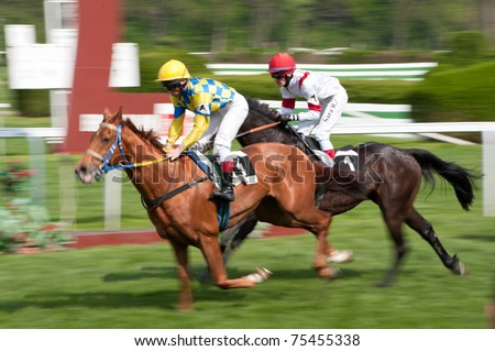 BRATISLAVA, SLOVAKIA - APRIL 17: QUEBEC INDIAN (ITY) ridden by J. Linek #4 wins Bratislava city Gallery Race, SO FANTASTIC (GB) ridden by R. Sara #1 second on April 17, 2011 in Bratislava, Slovakia