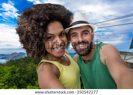 Brazilian couple taking a selfie photo in Rio de Janeiro, Brazil