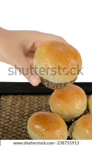 Bread buns in bamboo tray on white background