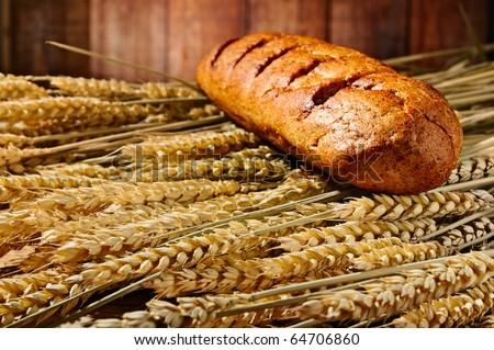 bread lying on the ears of wheat