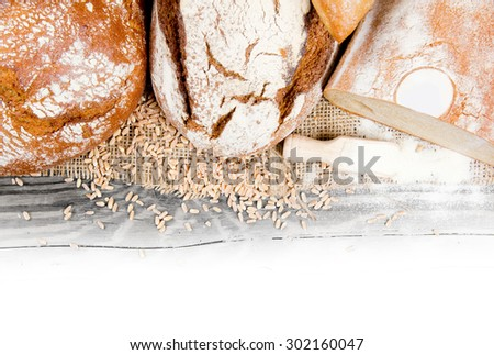 Bread slice with wheat seeds and flour on burlap with white space for text