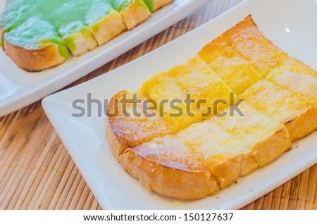 Bread with butter&sugar on top in whie dish