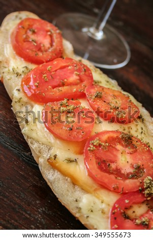 Bread with tomato and cheese