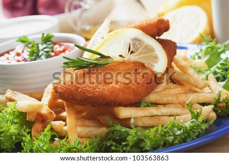 Breaded fish and french fries with chili sauce