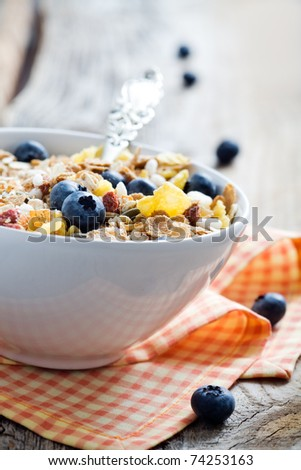 Breakfast cereal with fresh blueberries, selective focus