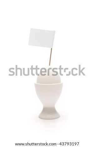 breakfast, white egg in egg holder with blank flag on neutral background
