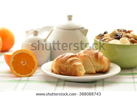 Breakfast with coffee, fresh croissants  on white  background, selective focus