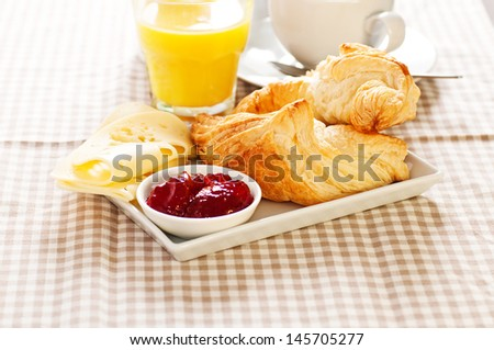 Breakfast with Croissant juice and coffee