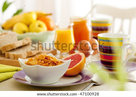 Breakfast with juice, fruits, jam and eggs
