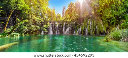 Breathtaking waterfalls panorama in Plitvice Lakes National Park, Croatia, Europe. Majestic view with turquoise water and sunset sunny beams, travel destinations background