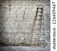 brick wall background ,  ladder near the wall - stock photo