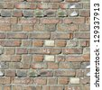 Brick Wall. Grey Old Brick Wall with Cracks, Dirt Spots and Inscriptions. Seamless Tileable Texture. - stock photo