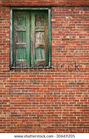 brick wall with high wooden door