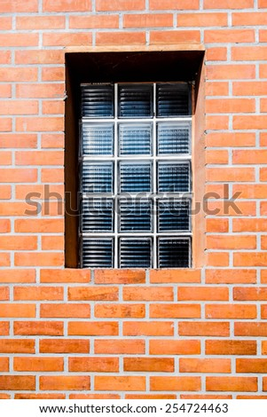 brick wall with window at center