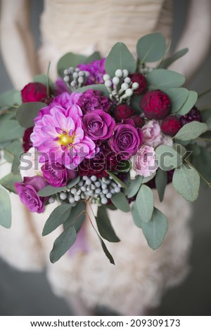 Bridal bouquet with red and burgundy colors