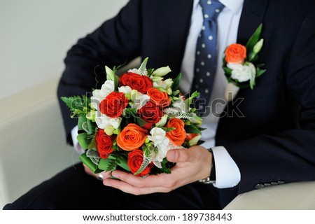 bridal bouquet with roses and lace
